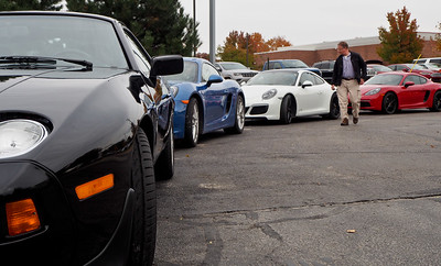 Old and new Porsches.