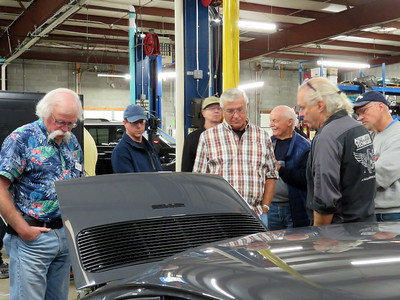 Participants  review the motor.