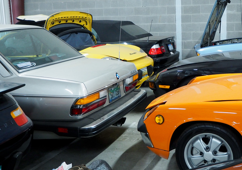 A variety of German vehicles awaiting repair.
