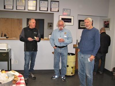 Tim Pott, Jim Schorr and Peter Grant enjoy their breakfast.