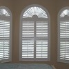 """Sunbursts of louvers accent the beauty of your arch top windows. Look best when the arch is a full half circle. These Norman wood shutters have louvers of 3.5"""" with the wide crown Z frames."""