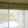 Woven shade trio - side by side,  makes a soft natural valance over Sunscreen roller shades