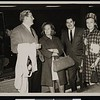 Ruben Salazar and wife Sally greet Chandlers at Mexico City Airport, Mexico City, ca. 1968 [front]