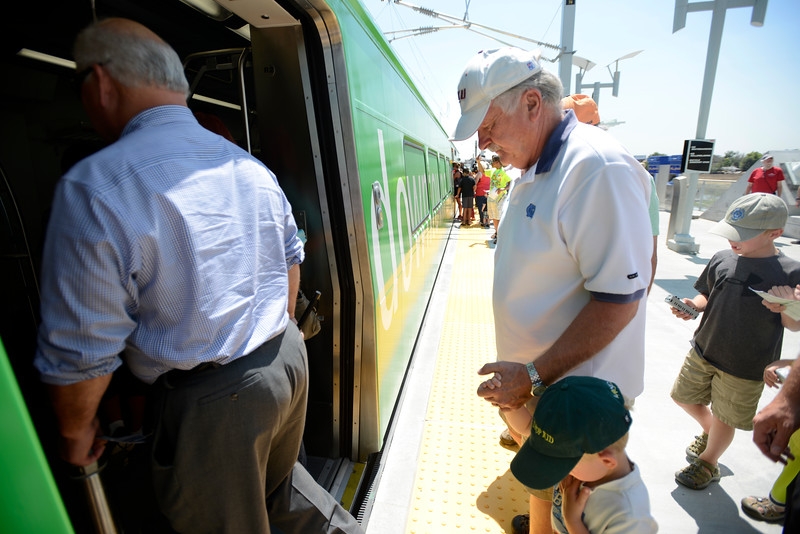 "Dennis Jones and Tyler Gerson, 3, board the RTD B line rail on Monday at the Westminster Station. For more photos go to  <a href=""http://www.dailycamera.com"">http://www.dailycamera.com</a><br /> Devi Chung For The Camera. July 25, 2016"