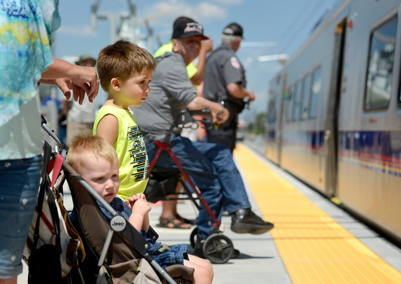 "Kalin McFarlin, 3, above, and Justin Shoemaker, 2, watch the RTD B line rail enter the Westminster Station on Monday. For more photos go to  <a href=""http://www.dailycamera.com"">http://www.dailycamera.com</a><br /> Devi Chung For The Camera. July 25, 2016"