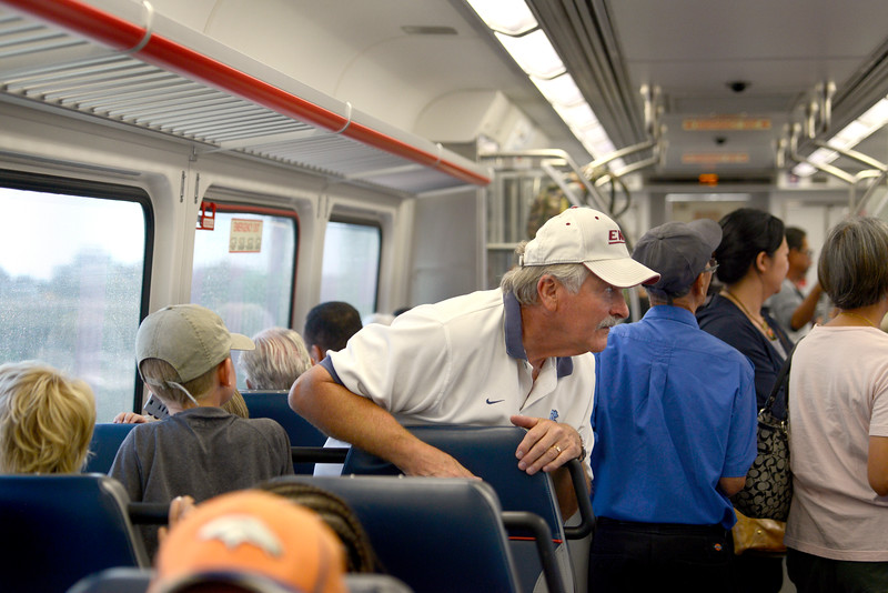 """Dennis Jones looks out the window of the RTD B line rail headed to Union Station in Denver on Monday. For more photos go to  <a href=""""http://www.dailycamera.com"""">http://www.dailycamera.com</a><br /> Devi Chung For The Camera. July 25, 2016"""