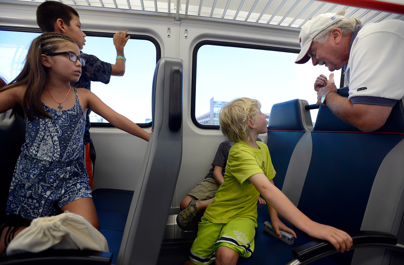 "Cole Gerson, 6, right, listens to his grandfather Dennis Jones as they ride the RTD B line rail out of Westminster Station on Monday. For more photos go to  <a href=""http://www.dailycamera.com"">http://www.dailycamera.com</a><br /> Devi Chung For The Camera. July 25, 2016"