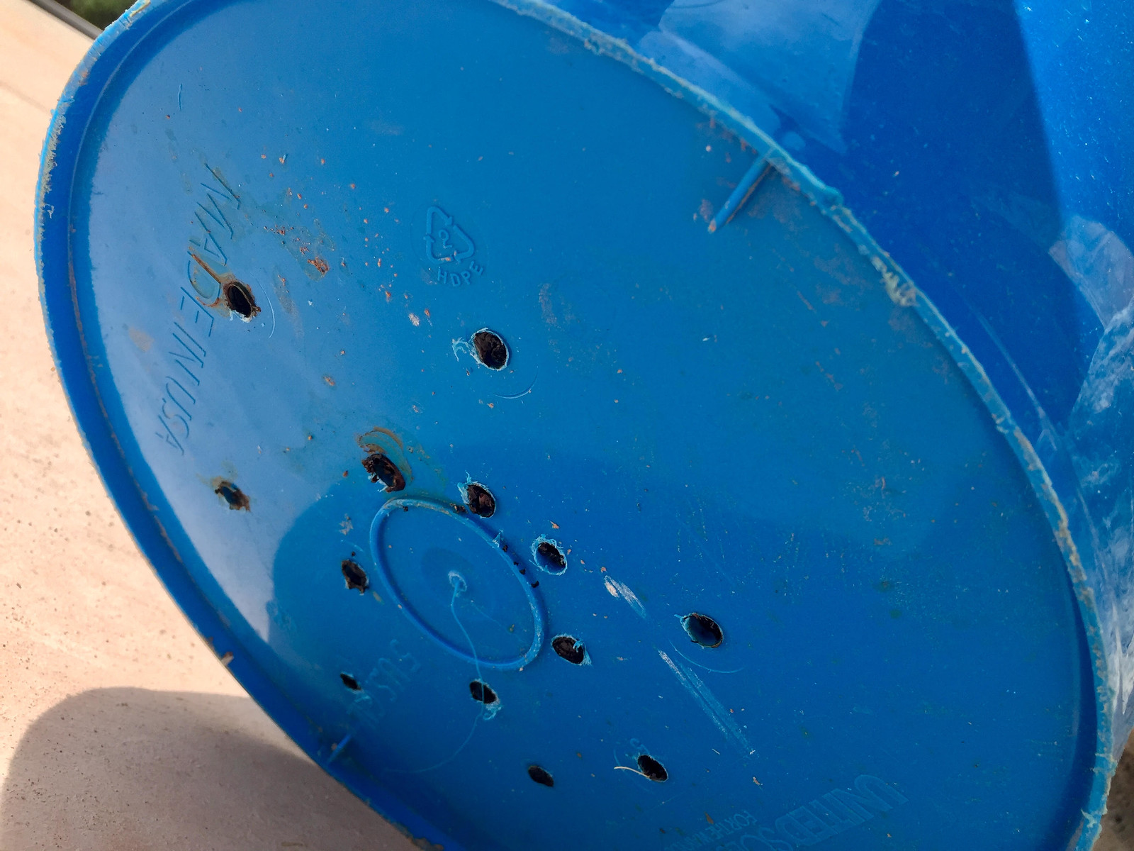 drill holes in bottom of potato bucket