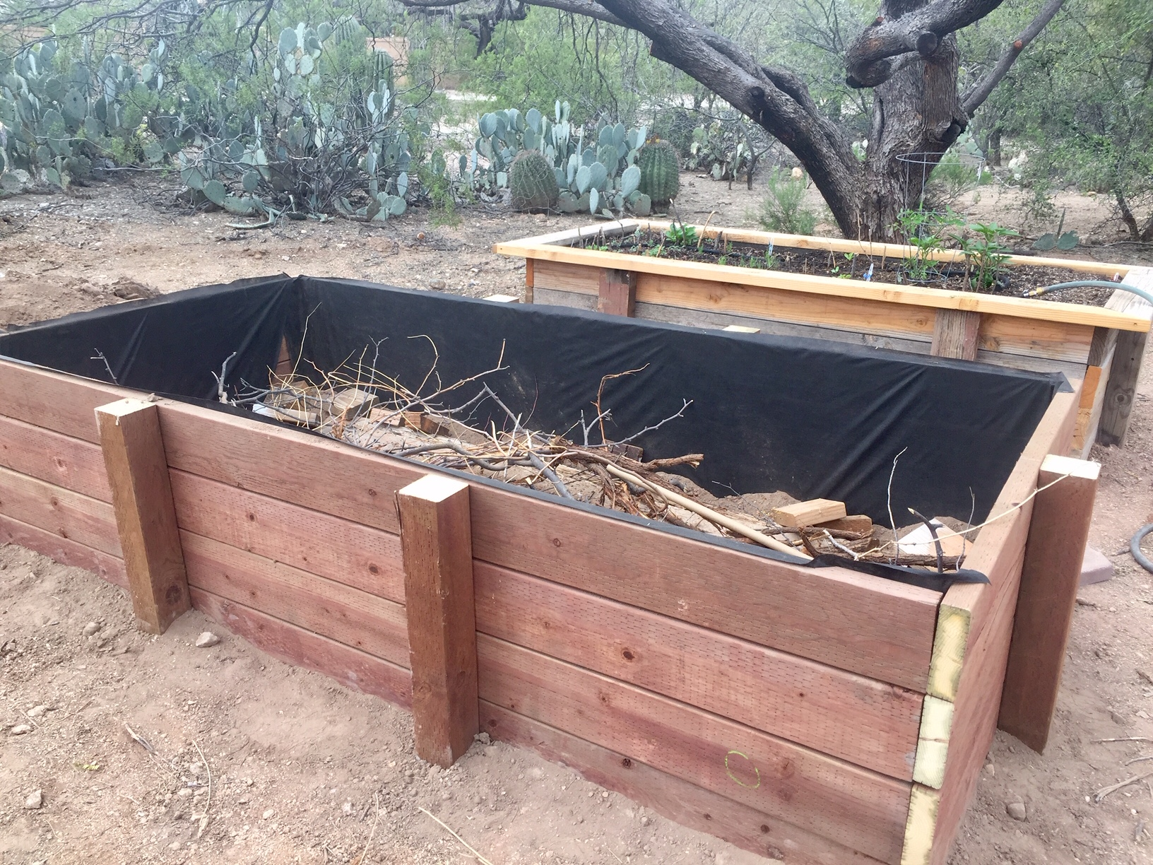 filling garden bed with twigs and branches
