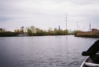 The industrial landscape of the South Branch forms a picturesque foreground for the Loop's skyline, as seen from the water.