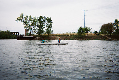 Deja and Ivory cruising in front of Canal Origins Park in the large turning basin where we launched the canoes.