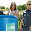 Environmental sustainability interns with RU's Physical Resources dept manage the water barrels at the Schaumburg Campus Community Garden, summer 2014