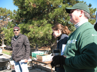 John Eskandari discusses soil preparation for gardening while Rep. Michelle Mussman and RU Assoc VP Paul Matthews look on.