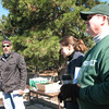 John Eskandari discusses soil preparation for gardening while Rep. Michelle Mussman and RU Assoc VP Paul Matthews look on.