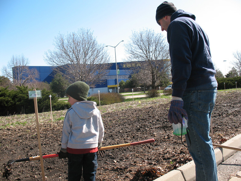 Here's RU biology prof Bob Seiser, who has one of the plots at the community garden, working with his son, Edmund.