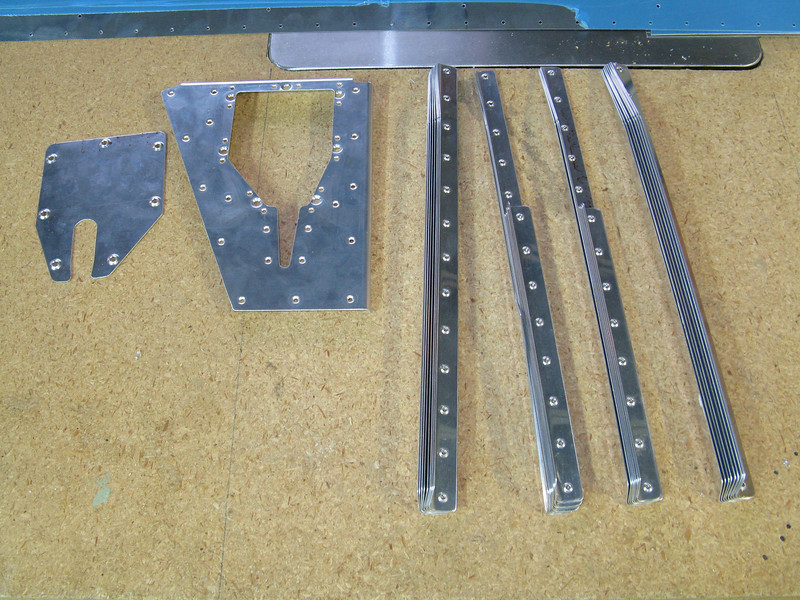 Elevator stiffeners and the trim plate were cut to length, deburred, dimpled, etc. Another couple of days work represented here.
