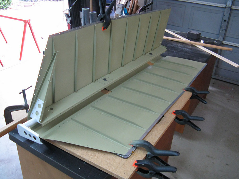 Here is the right elevator spread open in order to rivet the top skin to the spar. I was able to get my small tungsten bucking bar under there to set the rivets. At this stage I was just finished with back riveting the stiffeners to the bottom skin.