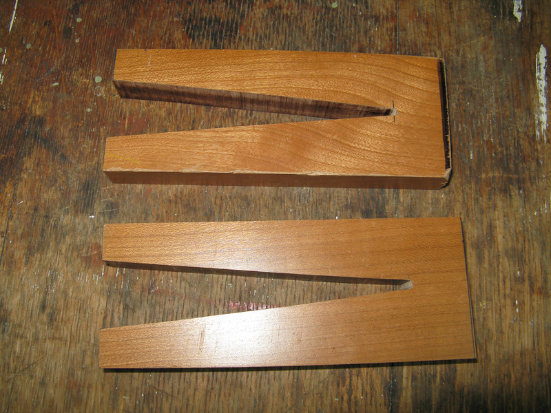 "I made these ""clamps"" out of hardwood. These will hold the skin down tight to the foam ribs while the sealant cures."