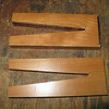 """I made these """"clamps"""" out of hardwood. These will hold the skin down tight to the foam ribs while the sealant cures."""
