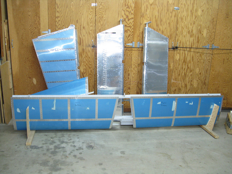 This is the mostly completed RV-9 empennage I purchased from another builder. The price was right, and I ended up getting more tools and other items from him than what he charged me, so the tail was essentially free.<br /> <br /> There were some issues with the elevators, trim tab, and rudder. The vertical stabilizer and horizontal stabilizer look OK, but there are some minor issues that remain. I took the left elevator completely apart and put it back together again just to get some experience with my new tools.<br /> <br /> After looking it over carefully, I've decided to scrap the entire tail and buy a new kit from Van's.