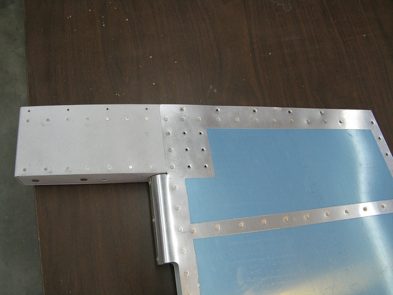 Top of rudder is missing some rivets where the counter balance and skins overlap.