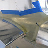 Time to get the empennage fairing fitting better. More clear heavy duty packing tape over the tail pieces, then waxed up. I mixed up some epoxy and brushed that on all of the interfacing surfaces, then mixed up some cabosil/flox mix and used a plastic knife to spread it over the epoxy. The hard part was getting this fairing on without smearing the epoxy over everything. Some painter's tape just to hold it flush to the aluminum.