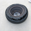 Little did we know that we drove the trailer over with a flat tire on the motorhome! I happened to notice that one of the rear tires looked like it was low on pressure. Actually, it was carrying the load of the other dual tire. This tire must have gone flat some time before today. I have no idea how long the motorhome was driven on a flat tire. The valve stem was missing on the rim, so it must have been fairly quick when it went flat.