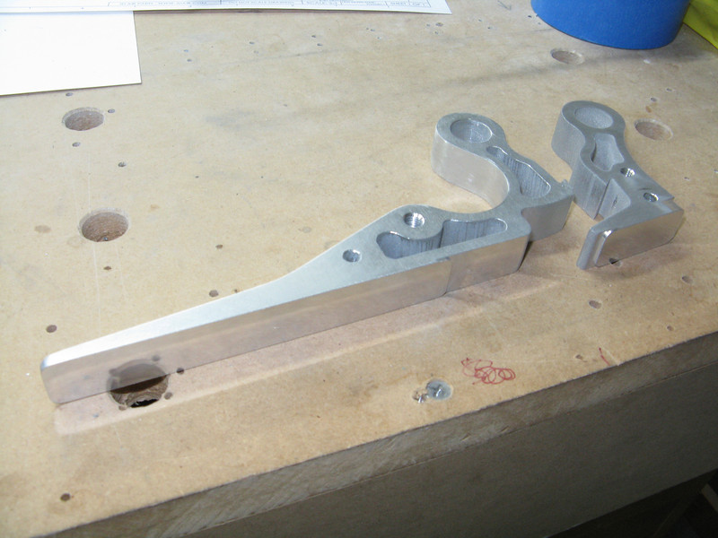 The JDAir latch is much nicer. However, the pieces as they come are pretty rough where it was cut out. The faces of the latch are machined, but the rest of the surfaces needed lots of sanding. I spent hours smoothing out the larger piece here with 220 wet/dry, and I hope to get this smooth enough to polish.