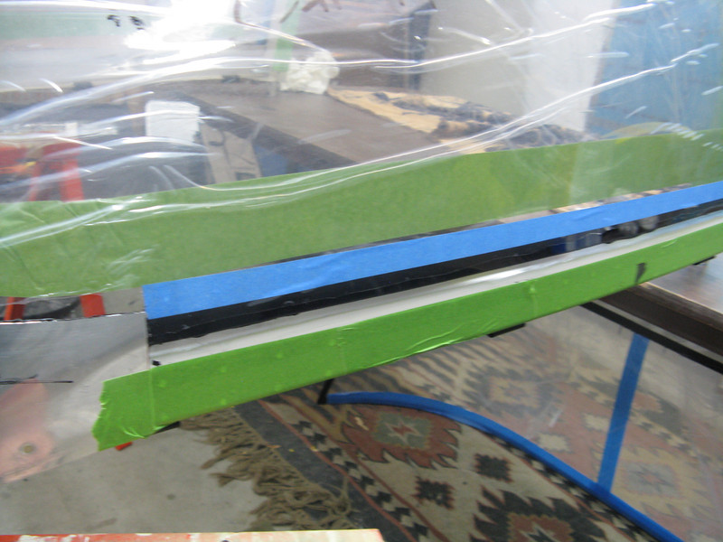 """You can see how nicely the sides got bonded to the frame. I will come back to the sides to rivet and bond the side skirts tomorrow. The """"ears"""" are nicely up against the plexiglass, with just a fingernails gap underneath."""
