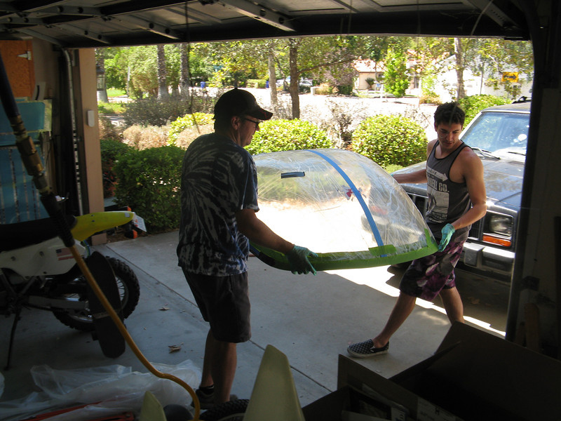 Alex and I moving the already primed bubble into position over the canopy frame.