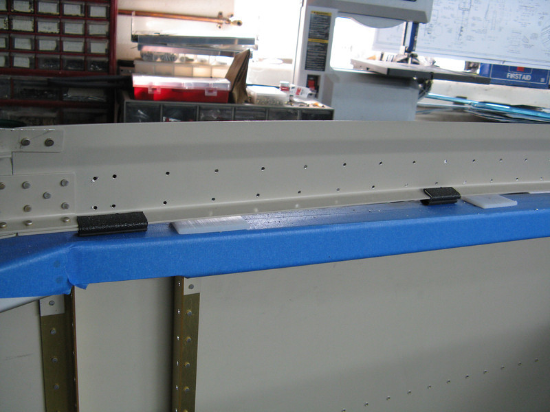 """Interior side of the side weldment on the canopy frame. The black spacers are small pieces of the weather stripping that I will be using along the frame. They are in place to help set the actual height of the side rails over the canopy deck. It is just over 1/8"""" gap."""