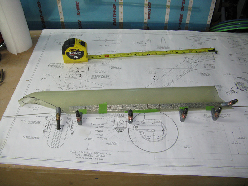 """I marked up the hinge and cut it to size. Plans say the hinge should be 21.5"""", but 18"""" is what mine ended up being. Taped the aft edge in place to make sure there is no twist, and used some cleco clamps to hold the hinge in place for drilling."""