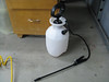 I got this 1 gallon garden sprayer from the local hardware store for $13. It worked great to fill up the brake lines. The Mighty-vac tool comes with all sorts of adapter fittings, including ones for the brake bleeding nipples. A combination of hose sizes and adapters was used to get from the wand tip to the brake bleeding nipple. The nipple only gets cracked open about a quarter of a turn, so there isn't a whole lot of flow going in. I put the brake fluid in the pump, gave it a dozen or so pumps to pressurize it, then opened the wand. A nice steady flow of fluid filled the tubing. I attached the tubing to the nipple and let it run. About 3 minutes later the fluid started coming out of the reservior. I had a brass connector with a hose barb on the reservior along with more clear tubing to catch the overflow in a container. I closed up the bleed nipple and did the same procedure on the other side. Brake pedals feel nice and firm!
