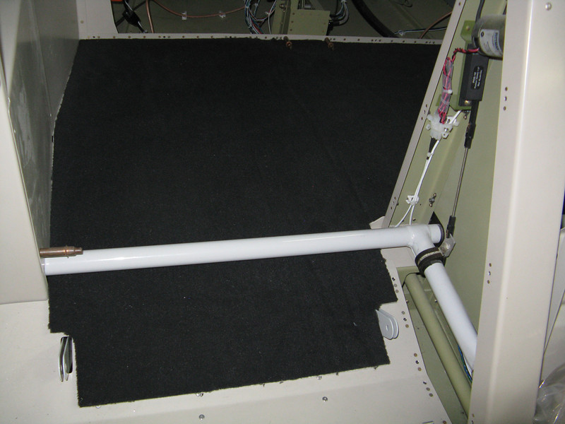 The other side of the baggage floor carpeting. I left it long going forward under the flap weldment and then down in between the seat belt anchors.