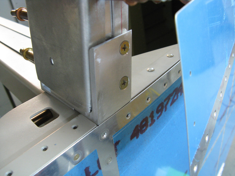 The attach bracket has several screws that hold the roll bar. There are two aft screws that hide behind the canopy skirt skin. These must be countersunk to be flush.