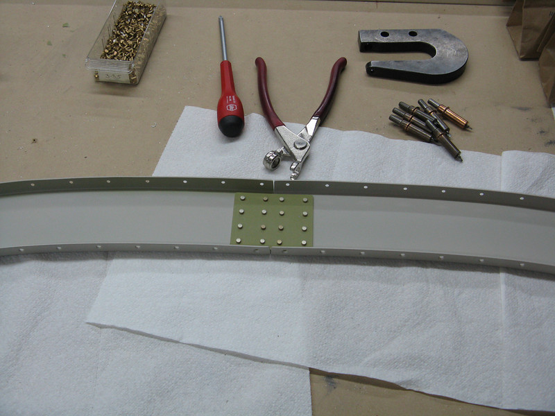 The front half of the roll frame doesn't have any additional angles. Just flush rivets on a joint plate.