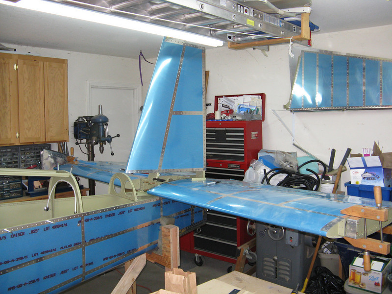 Vertical stabilizer gets set on next. Barely have enough room to clear the lights on the ceiling.