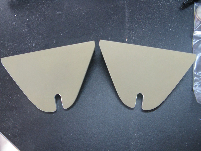 """The tank attach brackets get slotted after the 1/4"""" hole is drilled. This allows for the wing tanks to pull away from the fuselage in the event of a crash. The brackets on the wing tanks get a nutplate added, and then a single bolt will get installed here along with a large washer and some safety wire through the bolt head to keep it in place."""