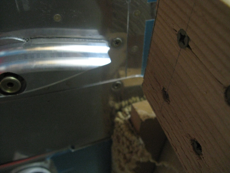 View from underneath the wing. You can see the other screw holding the gap seal in place on the bottom side. The fuselage cart that the fuselage is resting on was slightly in the way while fitting this. It took some work, but I was able to move the cart back just enough to get this screw in place.