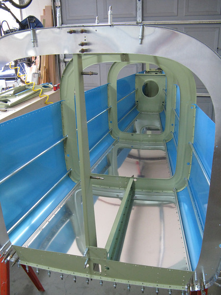 I added in the F-706 bulkhead and the ribs. The J-stringers are also now fitted to the sides and top of the tail cone.