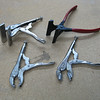 Sheet metal hand tools. The top 2 are seamers and are used to bend material. The vise grip pliers on the left have been modified with dimple dies. The pair on the right is used for fluting material.