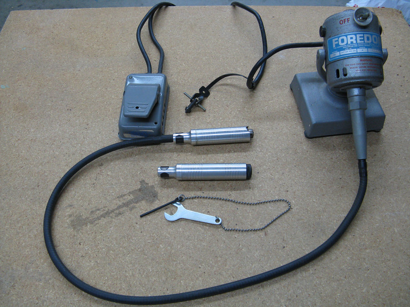 An industrial dremel-like tool. Comes with an optional foot switch. I also have a regular dremel tool.