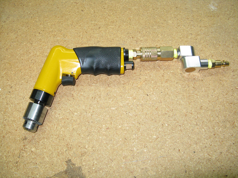 Air Drill. The quick connect swivel makes it easy to orient in any direction with the air hose connected. It spins really fast, but doesn't have a huge amount of torque like an electric drill.