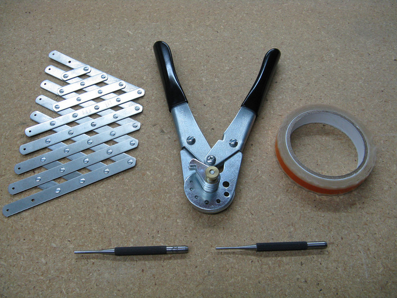 More rivet related tools. A rivet fan allows you to quickly lay out and space a line of holes. The tool in the middle is a rivet cutter. You use it to trim the length of rivets, if needed. The tape is rivet tape. The middle portion of the tape has no adhesive. You can use the tape to hold the rivets in place while back riveting. Pin punches at the bottom are used to remove drilled out rivets.