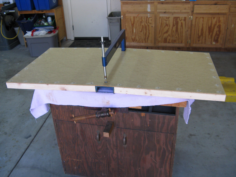 I fabricated a 2' X 4' surface that surrounds the C-Frame dimpler. Used some 2x4's that I ripped in half to frame the work surface. Used deck screws that are countersunk to hold it together.