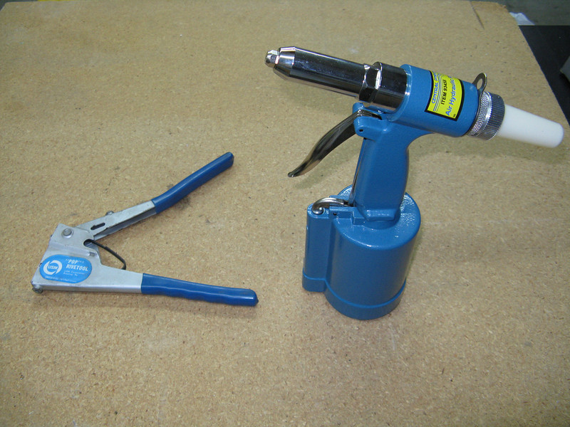 Pop rivet puller, and a pneumatic rivet puller.
