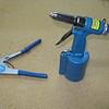 Pop rivet puller, and a pneumatic rivet puller.