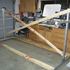 Another builder in the area kindly donated his wing jig. I added the cross braces. This jig is on wheels so it is portable, somewhat. It does take up most of my building area, but the advantage will be doing both wings at the same time.<br /> <br /> Update: I ended up ditching the cross braces. Too cramped to work on that side of the wings with them in place. With both wings clamped on, it is pretty stiff and sturdy (as long as the wing skins are on).