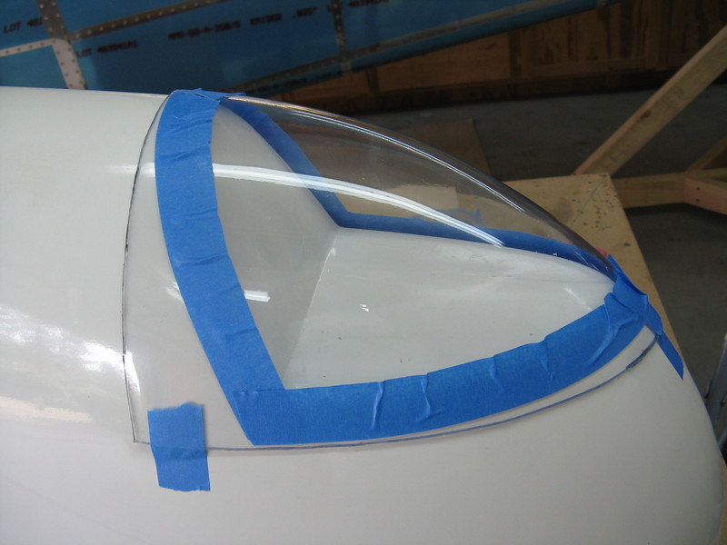 Pulled out and dusted off the large fiberglass wing tips and started fitting the lense covers. The cover first gets cut in half and then each half gets fitted to the tip. I started by marking off with blue painters tape where the recess in the tip lies.