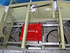 "Here is the heart of the plane's power. Vertical Power VP-X Sport. I fabricated this ""shelf"" to mount it behind the firewall. Power from the alternator/battery will come in on the left. Power from the unit is then distributed out of the two black connectors on the left. Smaller D-sub connectors on the right will go to the switches and sensors (flaps, trim)."